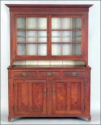 Signs of Spring at Pook and Pook - Pennsylvania walnut two part Dutch cupboard which sold for $22,515