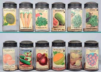 Conestoga Auctions: June, 2013 - One dozen Economy Glass canning jars with paper seed labels, Smoketown, Pennsylvania sold for $649