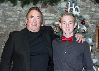 Brandywine River Antiques Market: Chadds Ford, PA - Michael McLimans standing by the Christmas tree with his son Hunter.