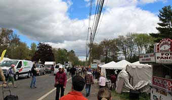 Brimfield Antique Market - Cars trying to dodge the enthusiastic collectors traveling from field to field.