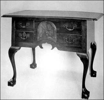 Connecticut Furniture - Cherry lowboy with shell carving at corners of top, center drawer curved, cabriole legs, ball and claw feet, ca. 1770-1780