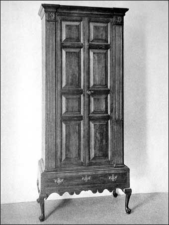 Connecticut Furniture - Cherry side wall cupboard on low frame, raise panelled door, cabriole legs, pad feet, stop fluted pilasters at side with rosette top, ca 1710-1720