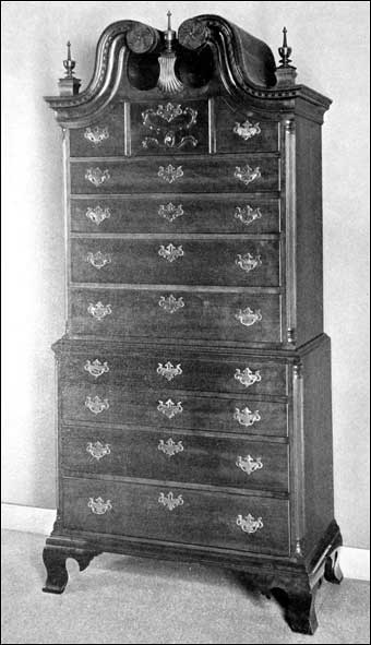 Connecticut Furniture - Cherry chest on chest, scroll top, dentil cornice, carved rosettes and handsomely carved base for urn shaped finials, raised carving on square drawer, quarter columns, curved bracket feet, Roberts type, ca. 1780-1790