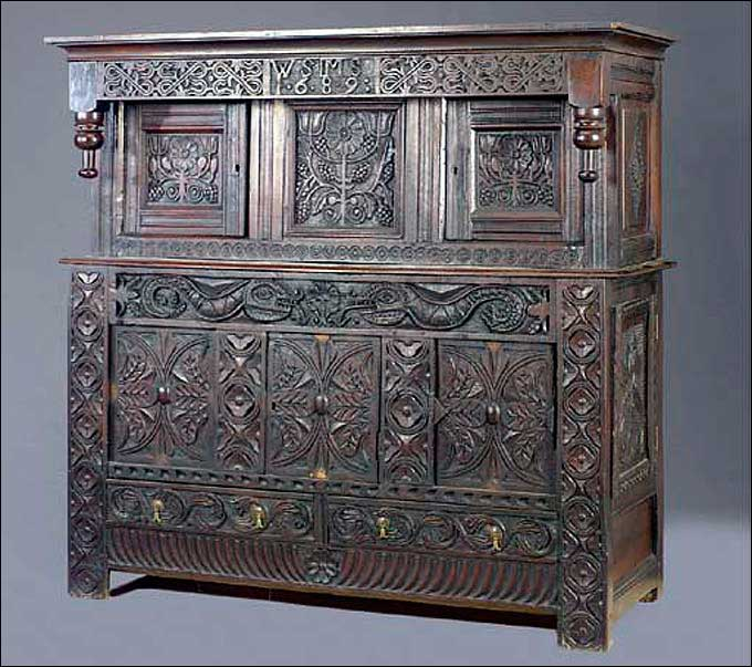 Furniture Styles - A Jacobean Joined Oak Press Cupboard, Part 17th Century, Dated 1689, Sold at Christie's September 7-8, 2005<br>