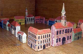 Christmas Toys - 19th Century Erzebirge houses more valuable than the previous set.