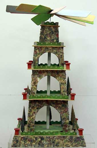 Christmas Toys - A large German five tiered Elastolin on wood Christmas pyramid with a colorful rock garden depiction with added trees, green fencing on all five levels. This pyramid sold at Bertoia Auctions, Vineland New Jersey in September 2012 for $375.