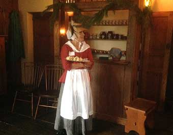 Two Colonial Gems, John Chads House and the Barns-Brinton House - Colonial lady serving light refreshments inside the Barns-Brinton House, 2014