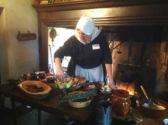 Two Colonial Gems, John Chads House and the Barns-Brinton House - Colonial lady cooking inside the Barns Brinton House, 2014