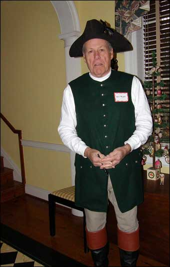 East Berlin Christmas House Tour - Bill Powell dressed up as a colonial man greeting visitors at the front door.