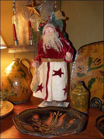 East Berlin Christmas House Tour - A decorated Christmas setting with a Santa, Schooner Redware, and a tin candleabra