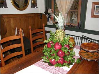 East Berlin Christmas House Tour - A decorated table in the dining room