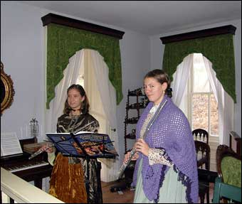 Hopewell Furnace, PA - Inside the Big House or Ironmaster's Mansion which was decorated for Christmas in the 1875 tradition. Flutists Alannah Sellman and Rachael Smith played Christmas music