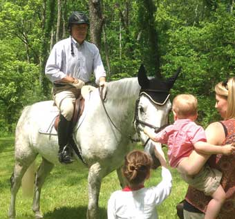 Hunt Country Stable Tour - A family enjoying the horse ridden by the owner of Wind Fields Farm, Tim Harmon on the premises of the Lime Kiln House