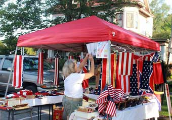 New Berlin Antiques, Arts and Crafts Show - Vendor selling flags.