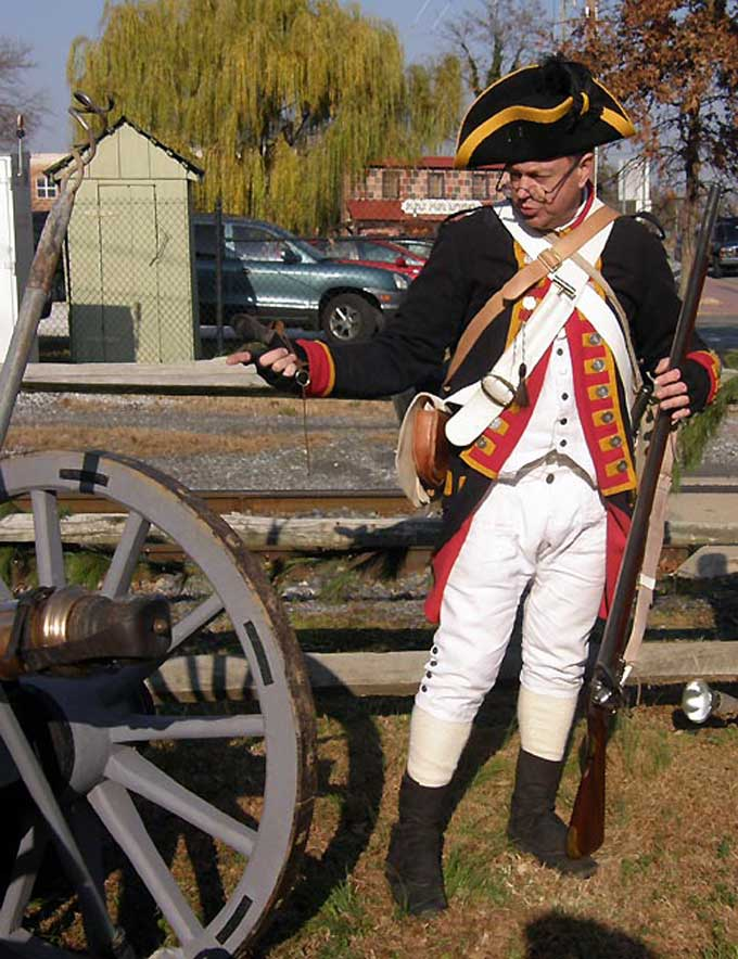 Salem, NJ Yuletide Tour - A Revolutionary War soldier demonstrating the use of a cannot at Johan Printz Memorial Park